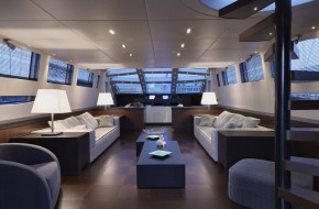 Italy, luxury yacht Tecnomar 36 (36 meters), dinette and staircase to the upper level (flybridge)